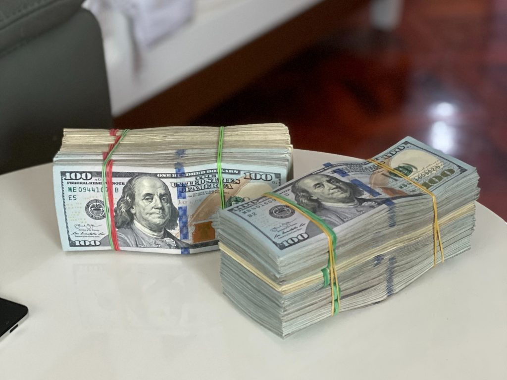 Stack of Cash -Oil and Gas Document Management